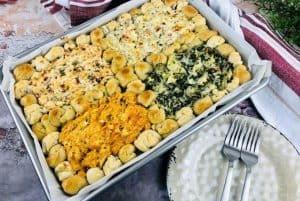 4 in 1 sheet pan warm gooey party dip appetizer recipe. Features buffalo chicken dip, bacon and cheese dip, cheesesteak dip and spinach artichoke dip