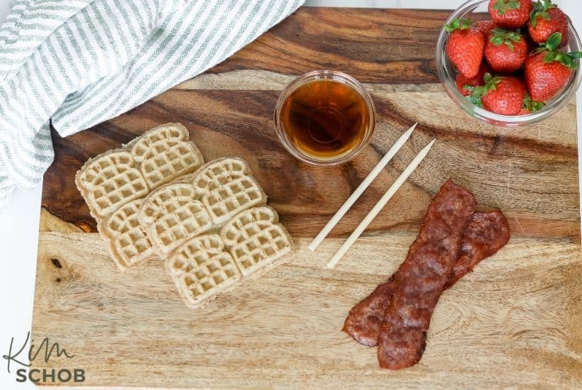 waffle skewers with mini waffles turkey bacon and strawberries served with syrup
