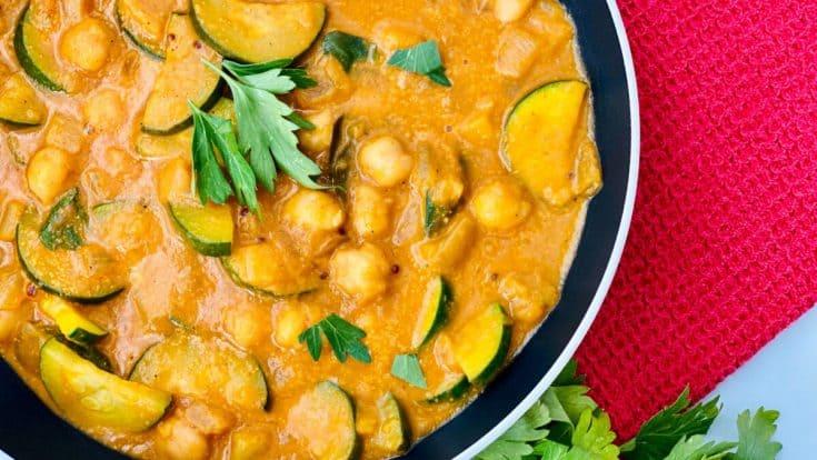 Zucchini Chickpea Potato Curry featured overhead closeup of curry in the pan e1624396137185 • Kim Schob