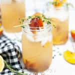 peach and thyme gin fizz in a mason jar