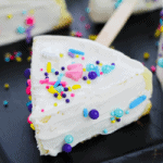 cheesecake on a stick with colorful unicorn sprinkles