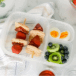 waffle kabobs with mini cinnamon waffles, strawberries and bacon served with a hard boiled egg, kiwi and blueberries
