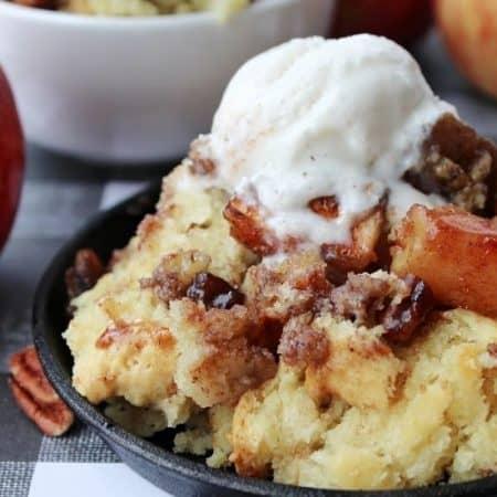 maple pecan apple cobbler with vanilla ice cream on top